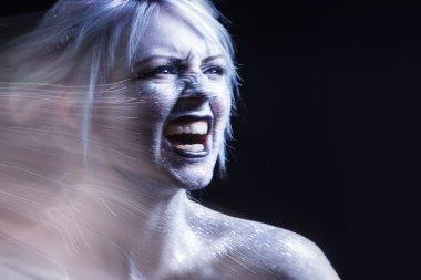 Portrait screaming woman. Bright neon fashion makeup, creative body art. Effect of movement