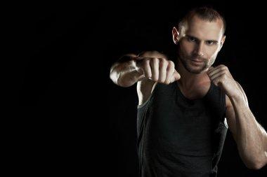 muscular man, hour boxer, black background, horizontally