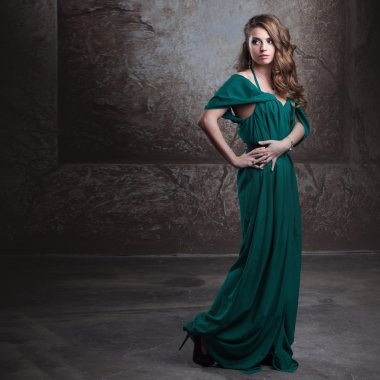 young attractive woman in green dress