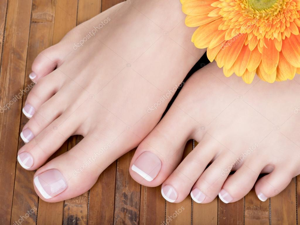 feet with french pedicure — Stock Photo © valuavitaly #103954346