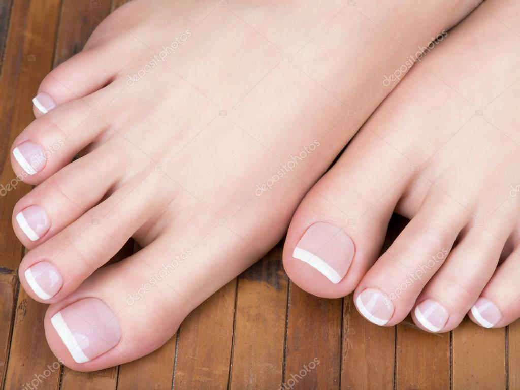 feet with french pedicure — Stock Photo © valuavitaly #103954596