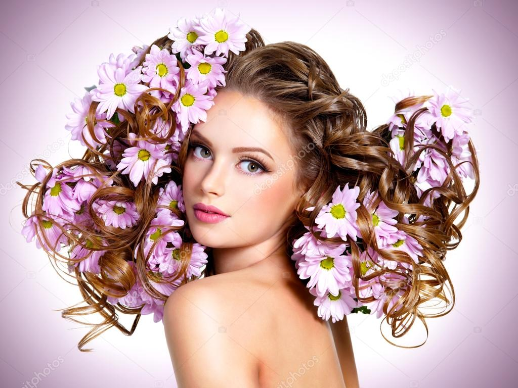 Young beautiful woman with flowers in hairs stock photo young beautiful woman with flowers in hairs stock photo izmirmasajfo Image collections
