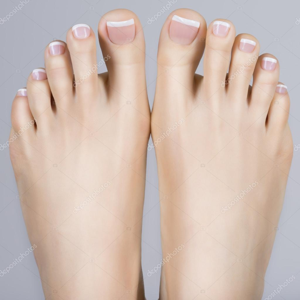 female feet with french pedicure — Stock Photo © valuavitaly #90846854