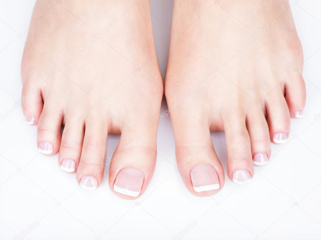 female feet with french pedicure — Stock Photo © valuavitaly #90847380