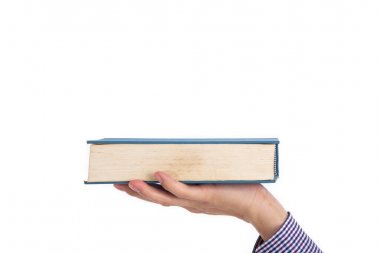 Male hand holding a book isolated on a white background,