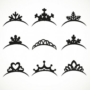 Set of silhouettes of tiaras of various shapes on a white backgr