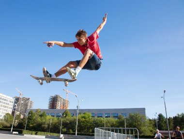 male skateboarder jumping on skateboard