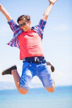jumping teen boy
