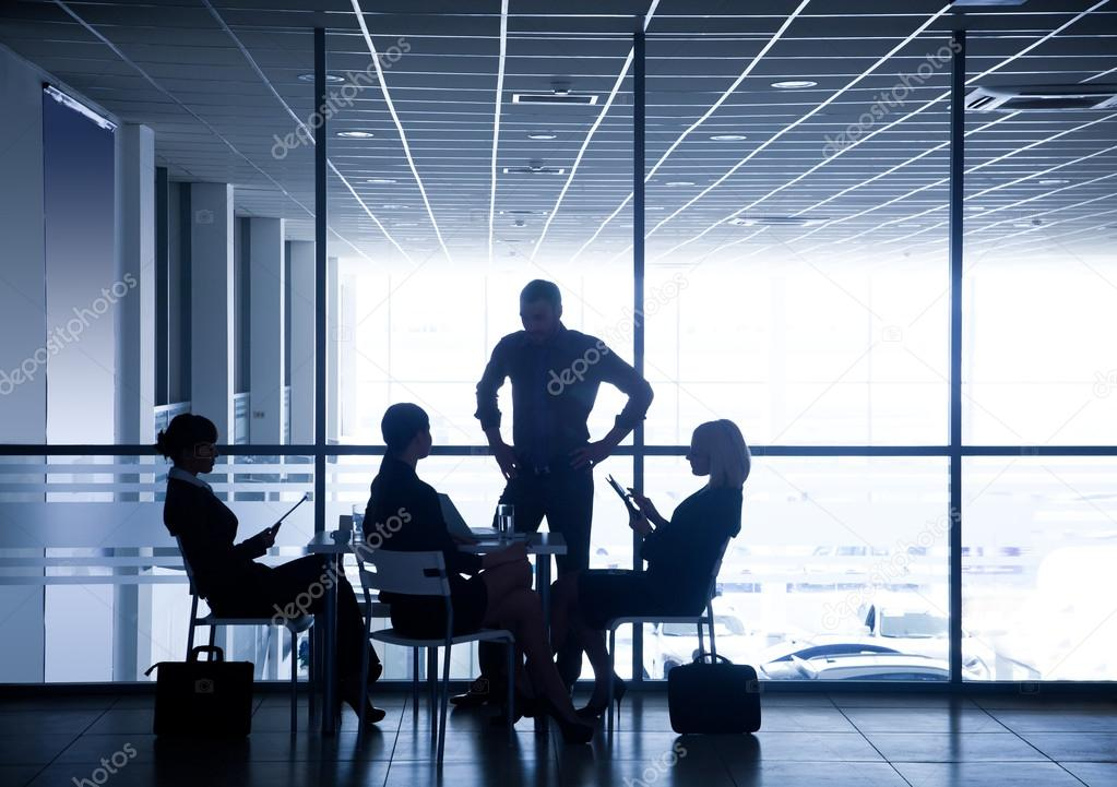 Silhouettes of businesspeople in business centre