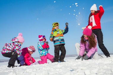 children playing in winter time