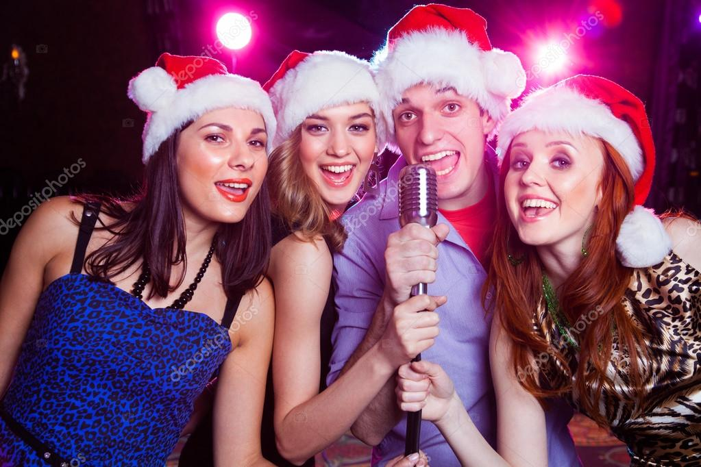 karaoke at christmas party — Stock Photo © yanlev #90288254