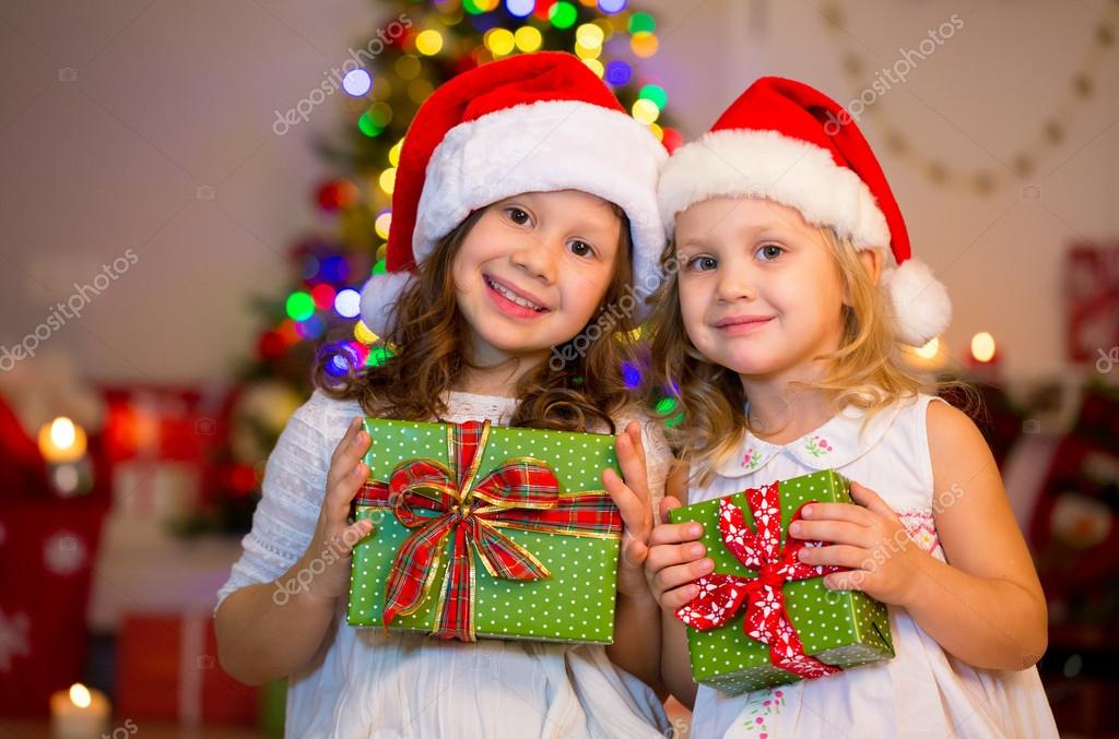 32f43bf4752d9 little girls in Santa hats — Stock Photo © yanlev  92351910