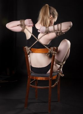 attractive woman tied with a rope.