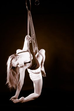 beautiful blond girl tied with rope