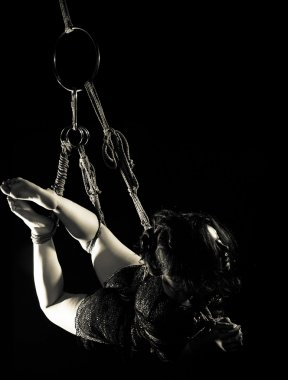 beautiful girl tied with rope