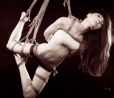 beautiful woman tied up with rope