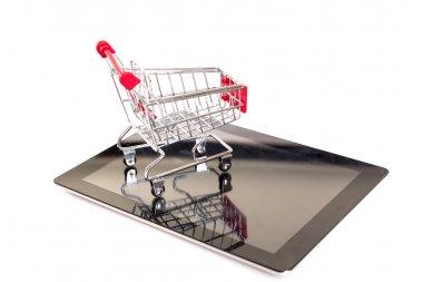 Shopping cart over a laptop