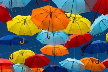Umbrellas coloring the sky