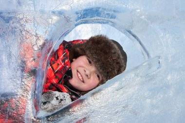 PERM, RUSSIA, Feb, 06.2016: Boy with an ice sculpture, urban esp