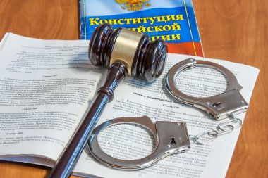 Judicial hammer, codes of laws  and handcuffs