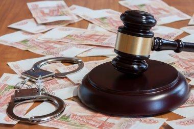 Gavel, handcuffs and Russian money