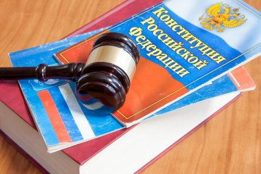 The judicial hammer and codes of laws lay on a table