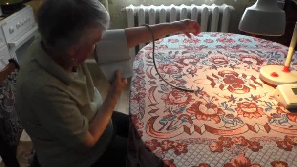 woman takes arterial blood pressure