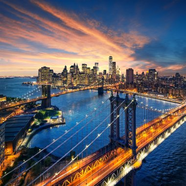 New York City - beautiful sunset over manhattan with manhattan and brooklyn bridge