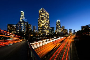 Los Angeles downtown after sunset with high traffic