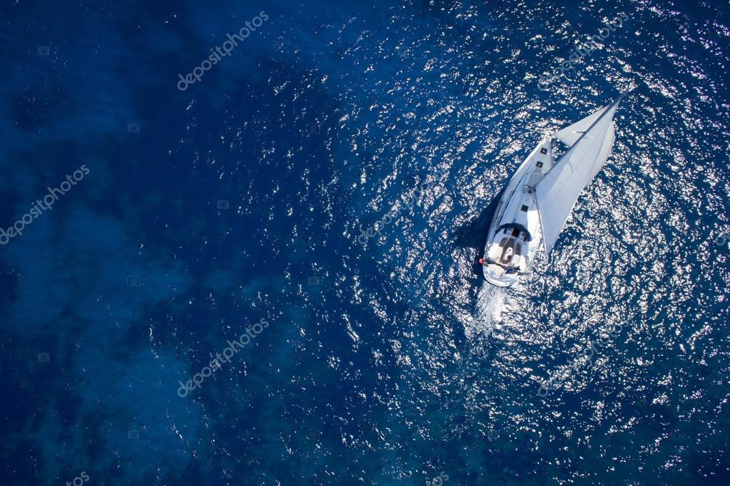 Amazing view to Yacht sailing in open sea at windy day. Drone vi
