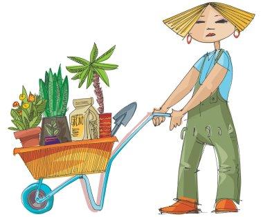 girl with wheelbarrow full of plants