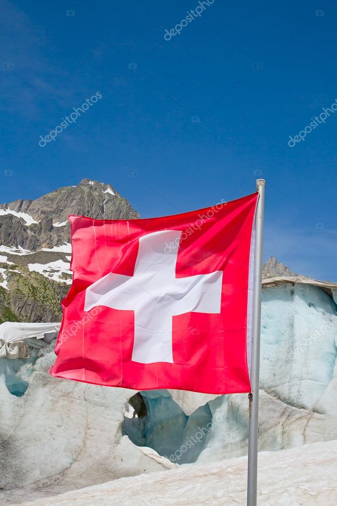 Swiss flag against mountains