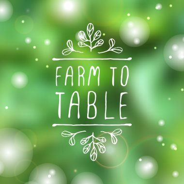 Farm to table - product label on blurred background.