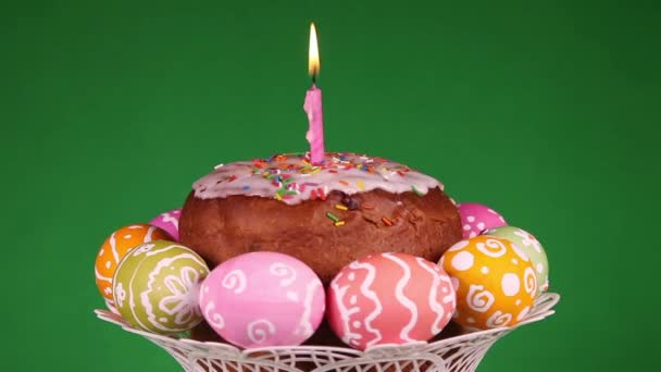 Easter cake with burning candle and eggs