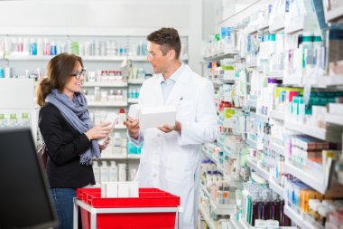 Customer Communicating With Pharmacist Over Medicines