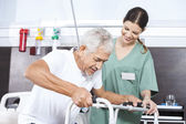 Photo Senior Patient Being Assisted By Female Nurse In Using Walker