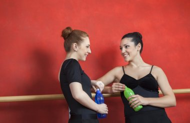 Friends Holding Water Bottles In Ballet Studio