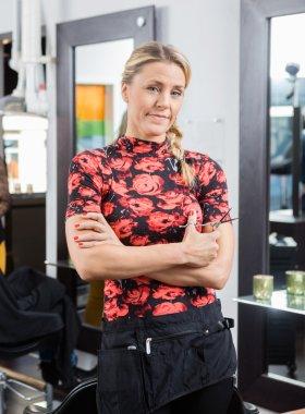 Confident Female Hairdresser In Salon