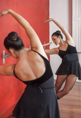 Ballerina Performing In Front Of Mirror At Studio