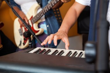 Mans Hand Playing Piano In Recording Studio
