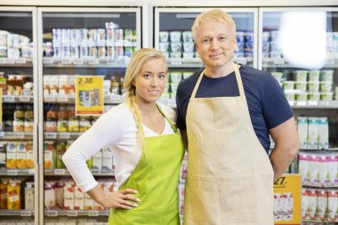 Workers Wearing Aprons In Grocery Store