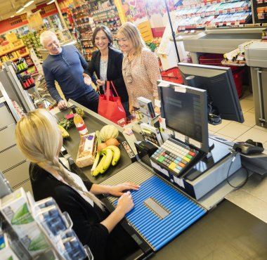 Cashier And Customers At Checkout Counter