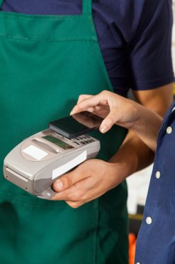 Customer Paying With Mobilephone Using NFC Technology