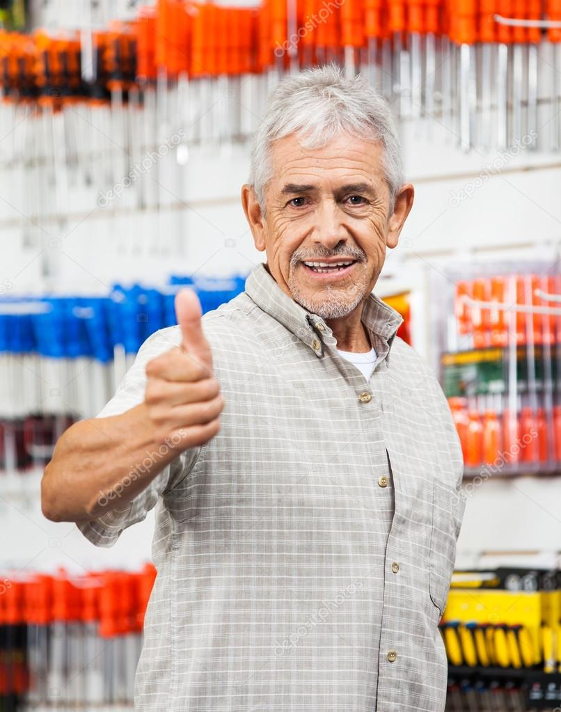 Customer Showing Thumbs Up Sign In Hardware Shop