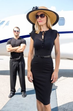 Beautiful Woman Against Bodyguard And Private Jet