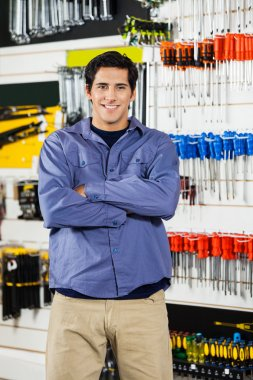 Man Standing Arms Crossed In Hardware Shop