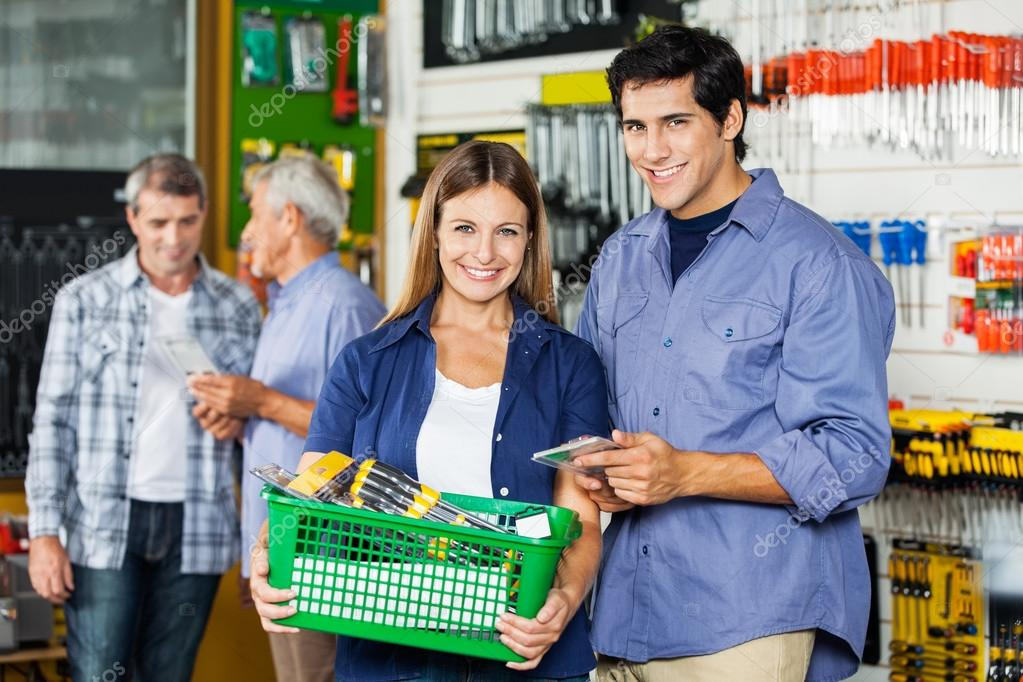 Couple Buying Tools At Hardware Store