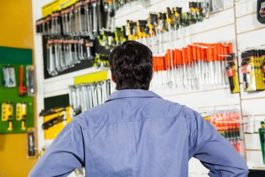 Rear View Of Customer In Hardware Shop
