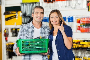 Woman Showing Something To Man In Hardware Store