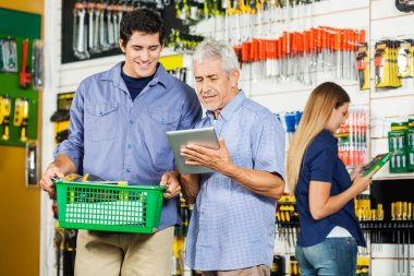 Father And Son Using Digital Tablet In Hardware Store